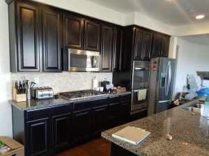 Before: White refinish on kitchen cabinets