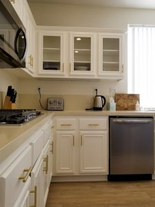 After: repainted kitchen cabinets and Island